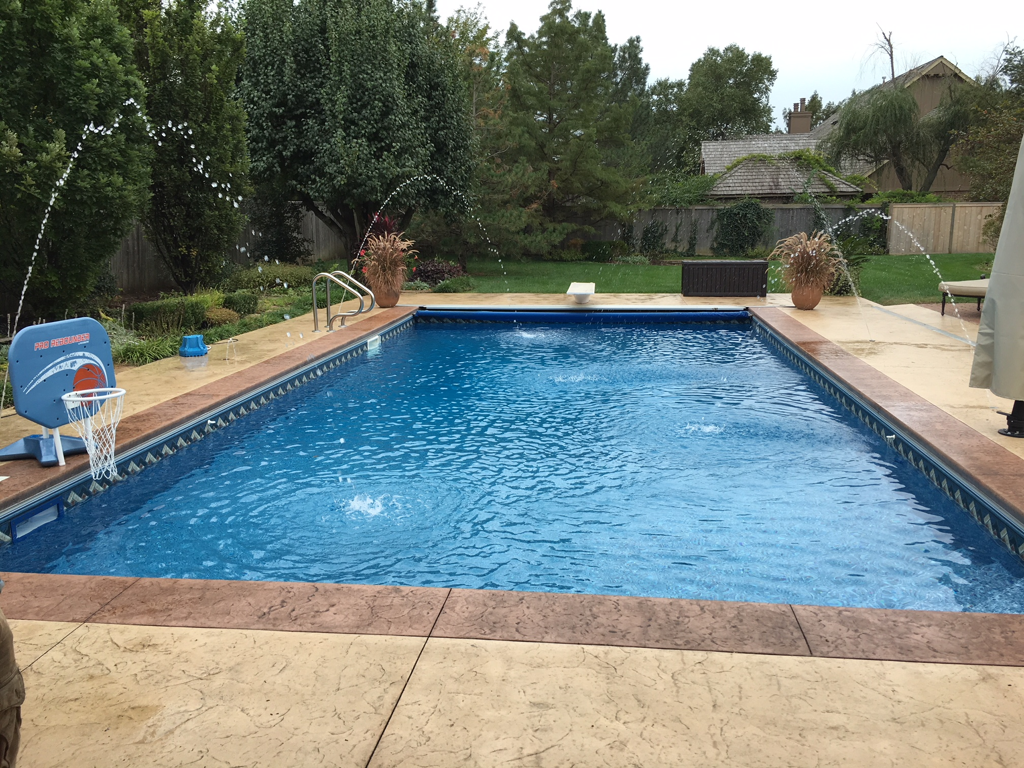 Patio designs pool remodeling wichita stamped concrete for Concrete swimming pool